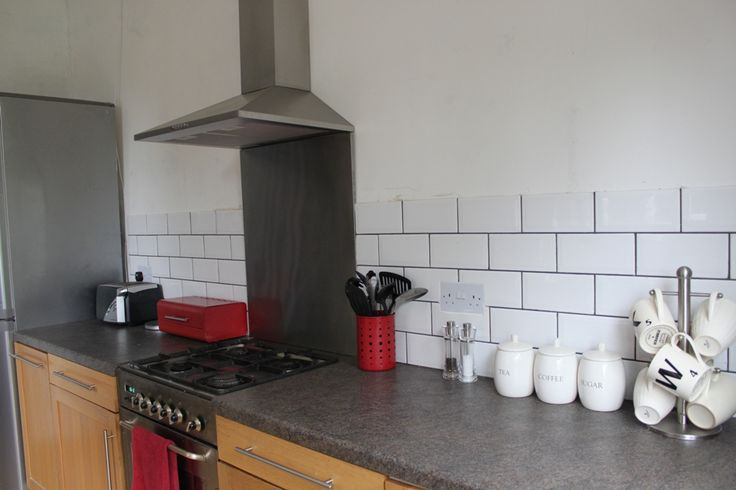 Progress Report:  White Brick Tiles and Shiny Cooker Hoods
