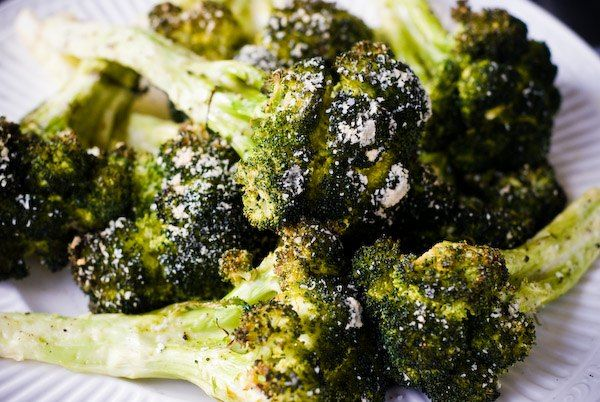 "How to grill broccoli. I have this philosophy that if I eat out, and there's a superfood on the menu, that's what I'm ordering. Last night, I made it at home. Something that I had never heard before is the idea of peeling the ""bark"" off of the stems to make them less chewy. It works! Get a good grade parma cheese. If you are going to have the calories, at least let it be good cheese."