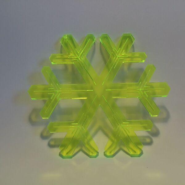 Plexiglass snowflake, flueroscent green. Designed and produced in Copenhagen.