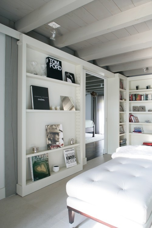 """love the """"books as art""""...could also be cute with designer handbags or shoes """"as art"""" and deeper shelving."""