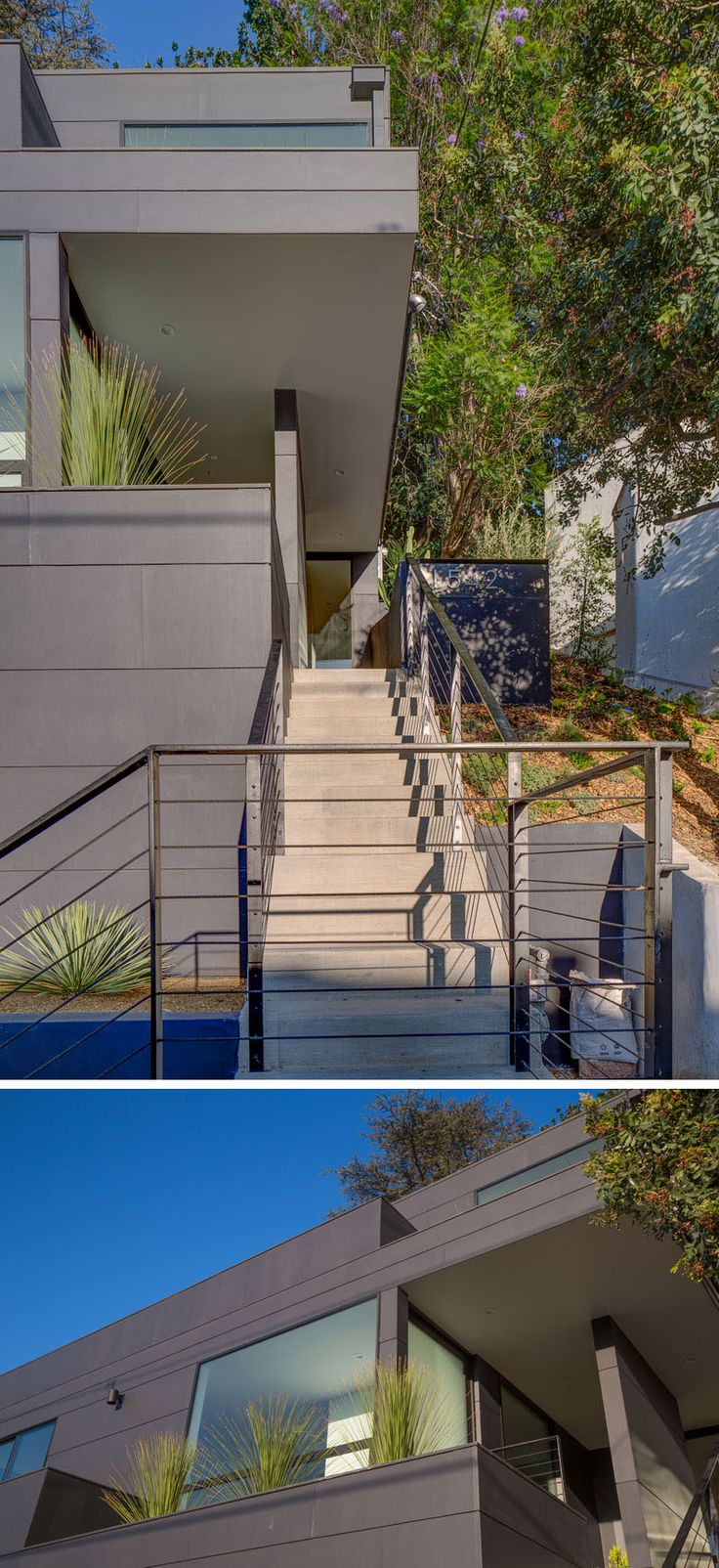 This modern house has concrete stairs with a minimalist black handrail lead up to a small covered deck that provides protection from the elements and access to the front door. #ExteriorStairs #Architecture