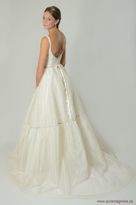 Balerina Inspired Wedding Dress Low Back by PureMagnoliaCouture, $2200.00 Modest wedding dress with a low back. Definitely not for busty girls who need bra's, but it is such a pretty detail.