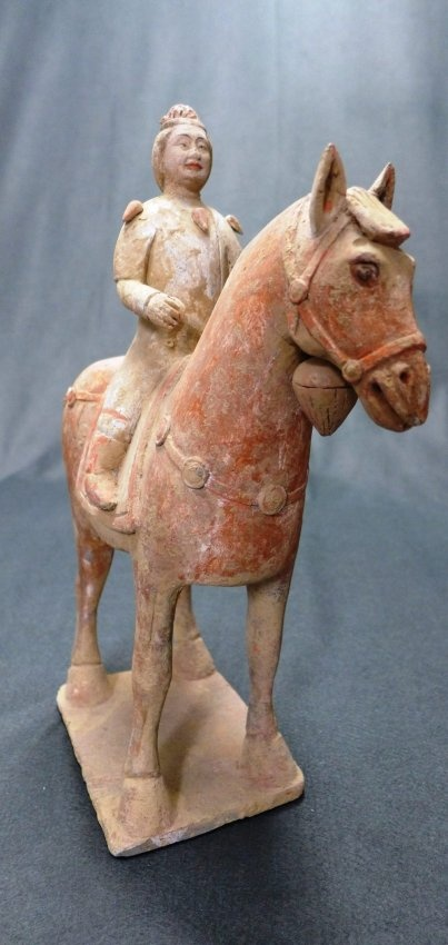 A  chinese Tang Dynasty pottery terracott horse and rider.