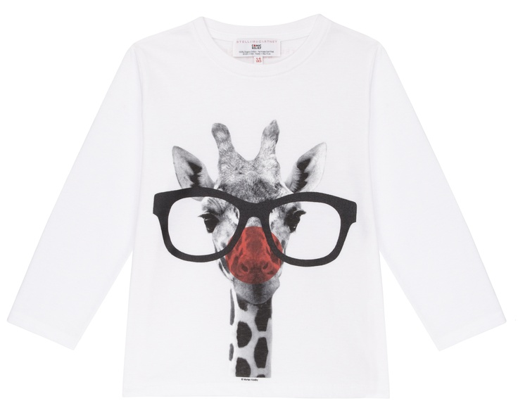 A white long-sleeved kids T-shirt featuring an image of a giraffe, with the addition of a red nose and glasses. Designed by Stella McCartney exclusively for Red Nose Day. With at least £2.50 going to Comic Relief, helping to change lives across the UK and Afric, t-shirt is £6.99. 100% organic Fairtrade certified cotton. Wash at 40.