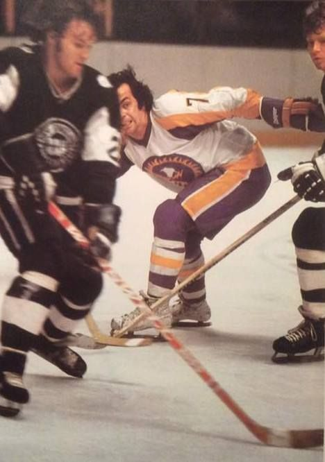 Rick Ley of the New England Whalers vs. Andre Lacroix of the New York Golden Blades.