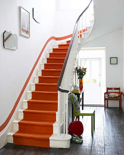 Vibrant orange fitted runner with painted stripe on the wall