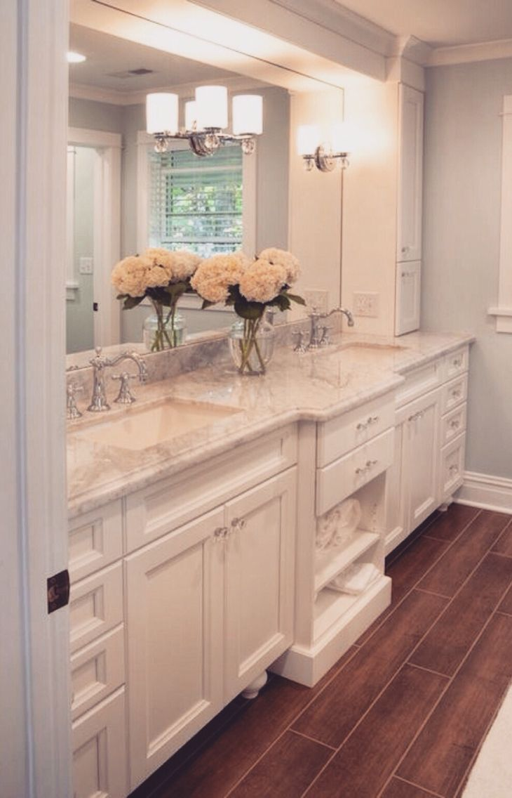 "Double sinks, glass knobs, porcelain ""wood look"" tile"