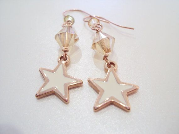Rose gold and white star dangly earrings with Swarovski crystals and rose gold plated brass