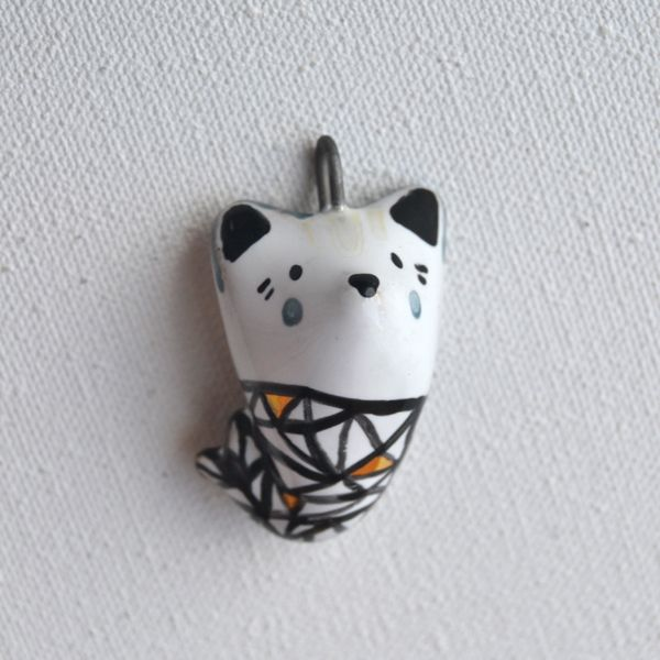 Geometric mermaid-wolf necklace 25.00€  Sweet little wolf dressed as a mermaid can't wait to swim around the world with you.  This item is 100% handmade high quality ceramics, glazed. Three times fired. Decorated with genuine gold. Comes with chain.