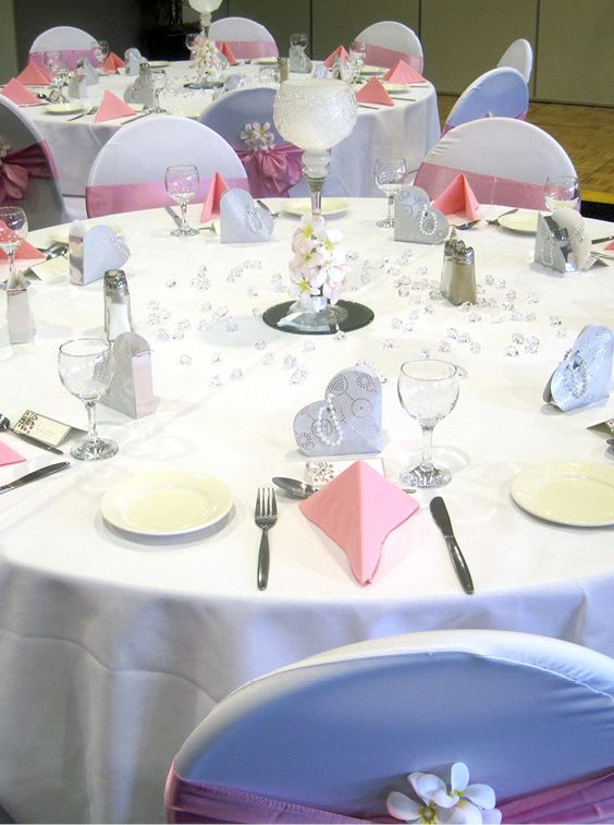 Pink & white wedding reception with frangipani's