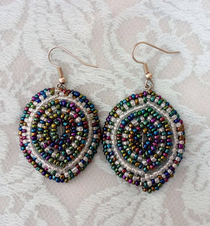A pair of clear and peacock statement earrings. Handmade by myself, Annalee Beer of EverAfter Artisanry.