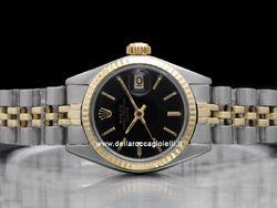Rolex - Date Lady 6917 Cassa: acciaio - 26 mm Ghiera: oro giallo Vetro: vetroplastica Colore quadrante: nero Bracciale: jubilee Chiusura: deployant Movimento: automatico