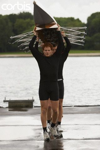 Rowing Team Carrying Racing Scull