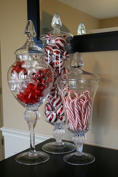 Decorations (bows, ornaments and candy canes in glass jars)