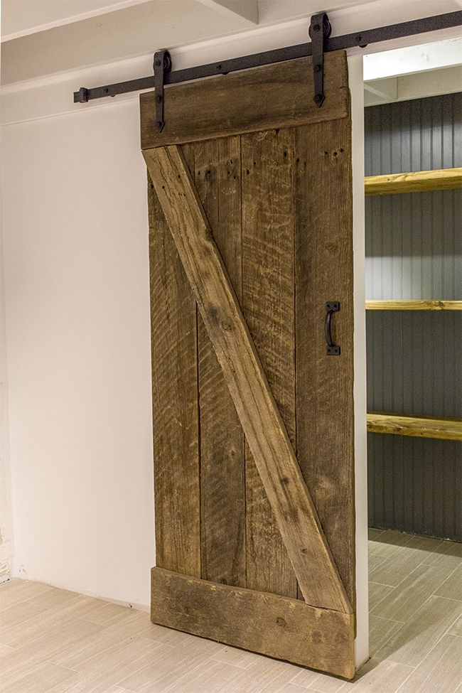 $20 barn wood + $90 hardware kit = authentic barn door! Tutorial inside.