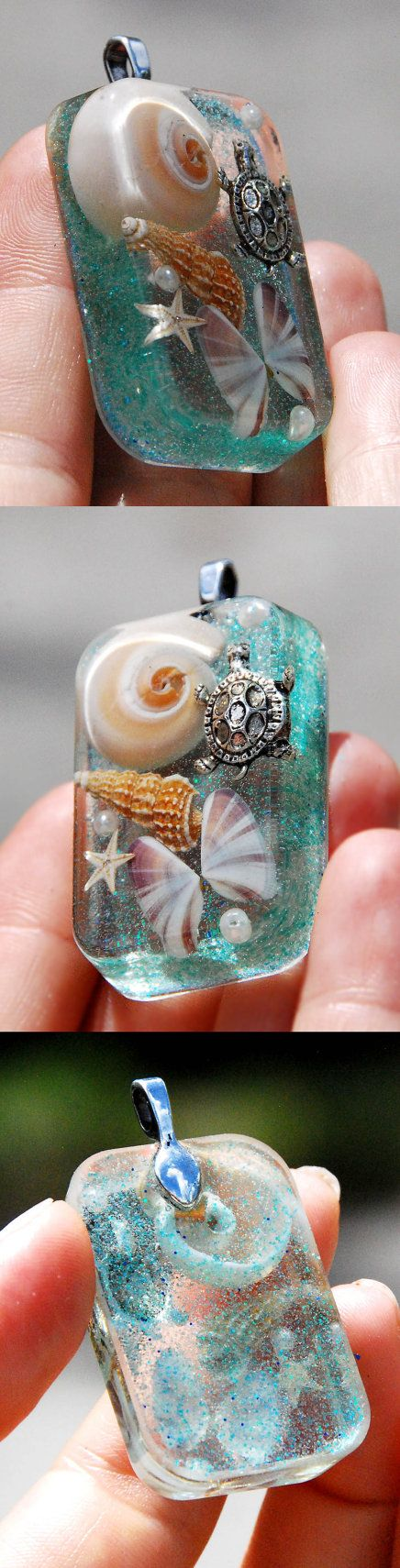 ♥  Are you thinking what to get your mom for Christmas? Are you looking for Christmas gifts for wife? Let her feel beautiful and inspired wearing this totally unique sea necklace! The handmade pendant features real seashells, real starfish, and a tiny charm turtle frozen inside the resin jewelry piece. This art jewelry pendant has a very gentle glitter sparkle of the ocean waves!  The necklace comes with a genuine 925 sterling silver chain (Italy) and the handmade pendant looks like a sem...