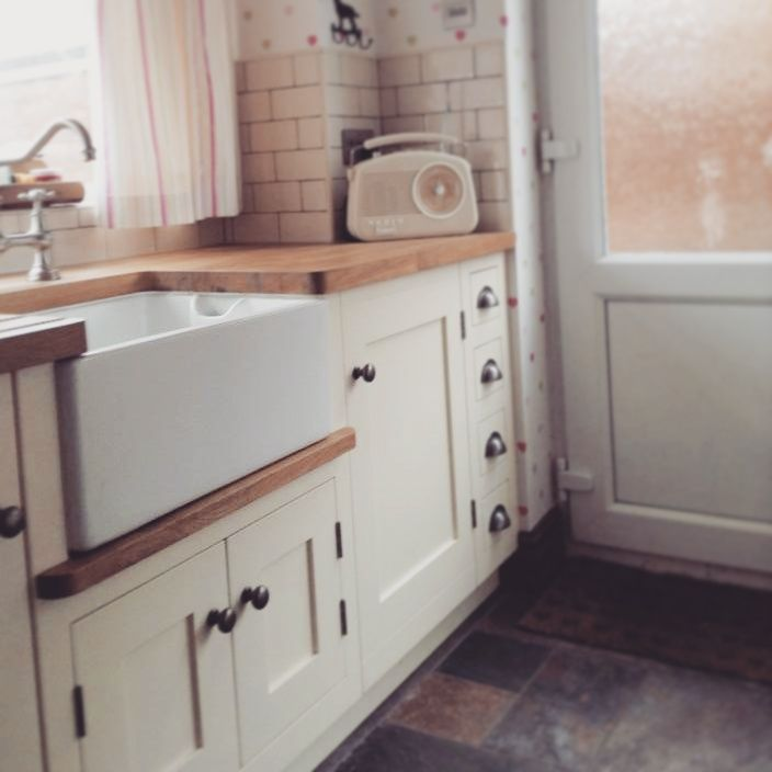 Hand painted, traditional cream kitchen with Oak work tops.