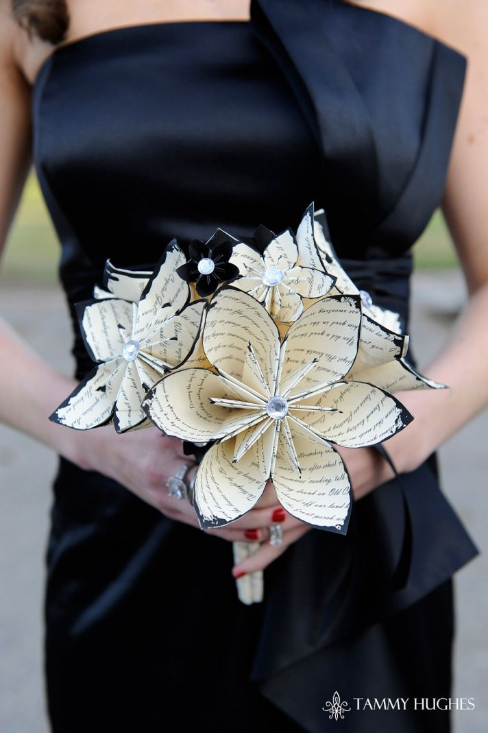 Here's the paper flower bouquet I had found.  To me it looks like they lined the edge of the flowers with blue ink or paint.  I suppose the paper could also be book quotes, or even use the galyfreyan on the paper then make it in the bouquet.    music themed wedding accessories ceremony reception decor paper flower centerpiece