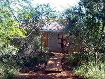 Hluhluwe 7.7m 21ha Lodge on 21 Ha of natural forest close to the N2, fully fenced. Game on the property include several Nyala, duiker, suni and prolific birdlife. Buildings on the property include dining area/kitchen and bar with attractive views over the hills of Phinda and 6 guest chalets nestled in the bush, each with 2 twin bedrooms and 2 en-suite bathrooms. Each room has air-conditioning, fridge, tea and coffee making facilities and private veranda. Other buildings include 1 large fully…