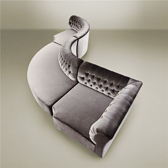 Modular sofa, available in custom sized. Upholstered in Promemoria's fabric or COM fabric with not removable cover, back in capitonné. Available with padded armrests and side table in wood. http://www.promemoria.com/