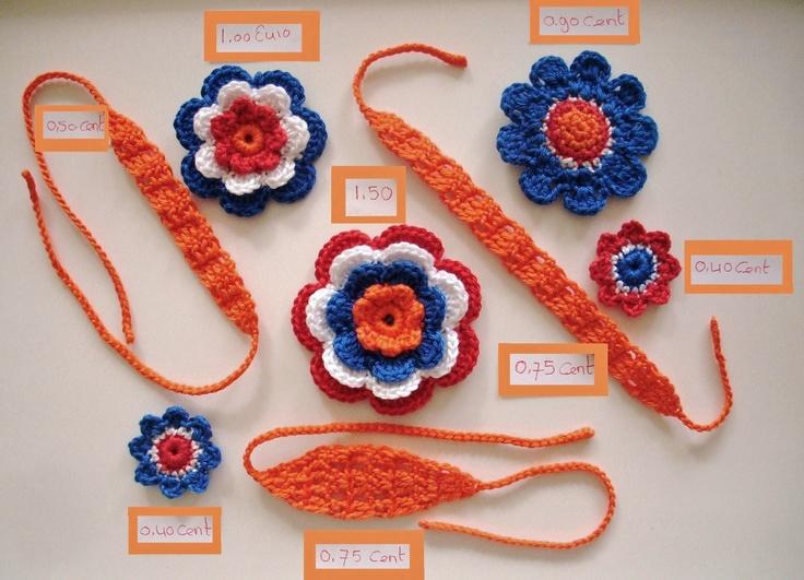 Haarbandjes oranje met rood wit blauwe bloemen