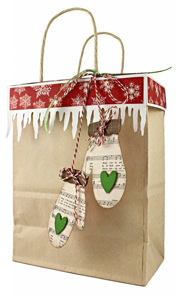 On the third day of Christmas the Pazzles Elves gave to me…    This gift bag topper turns a plain kraft bag into a wow gift in just a few easy steps. As an added bonus, the top can be glued on to prevent pre-Christmas peeking. The topper is made to fit a standard 8″ x 10¼″ kraft bag which you can find at most craft stores.