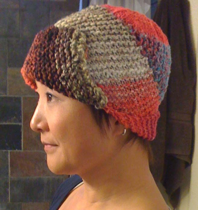 Knitted hat in Hand Dyed Noro Yarn It is basically long strip sewn in spiral pattern to make a hat