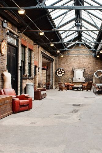 This East London Warehouse   Most recently a motor mechanics - comes minus a wedding licence, but its sheer space and Aladdin's Cave quality of vintage props provide the backdrop for a highly unusual blessing/reception. Couples can select from different floors (with parquet, mezzanine and oak boards), with the industrial charm of skylight roofing, textured walls and random leftover furniture from film and photo shoots bound to delight..