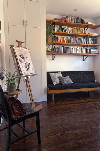 Nordin designed the custom shelving in the office using salvaged wood and vintage parts. She also reupholstered the midcentury Danish bench below.