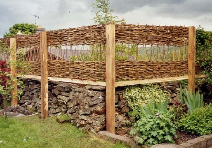 An open trellis in the panel gives privacy with a feeling for Wooden garden screen designs