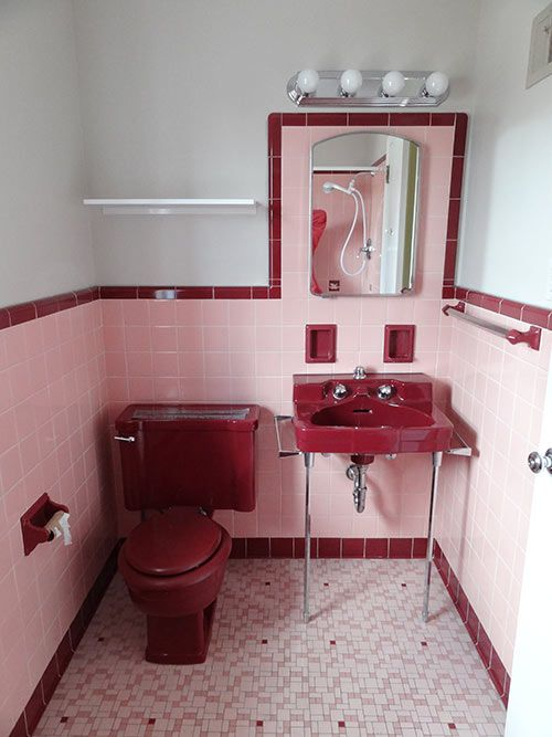 A vintage pink and maroon bathroom. Wow...like walking into Grandma's