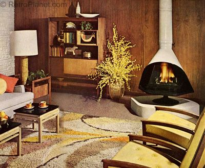 Mid-century modern living room image -- probably an ad -- using a free-standing fireplace as a tv-console. Description from pinterest.com. I searched for this on bing.com/images