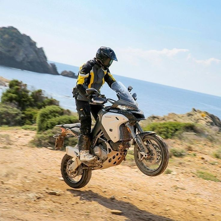 regram @ducatiuk  Wheelie Wednesday with the @theonecalledllel and the new Multistrada 1200 Enduro. Llewelyns review is now online at @brakemagazine. Go check it out!   #Ducati #Multistrada #Multistrada1200Enduro #BrakeMagazine #smcbikes http://ift.tt/1UligCn