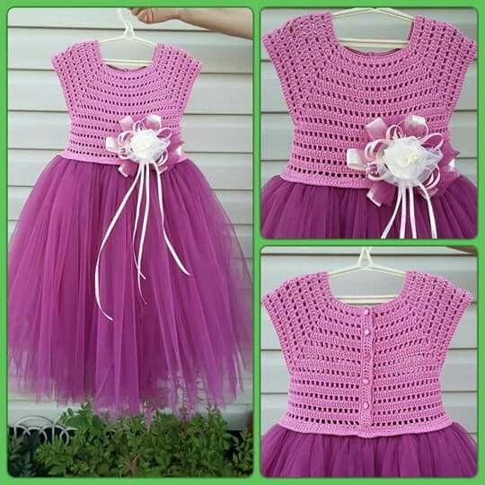 Vestido rosa de niña con detalles TEJIDOS