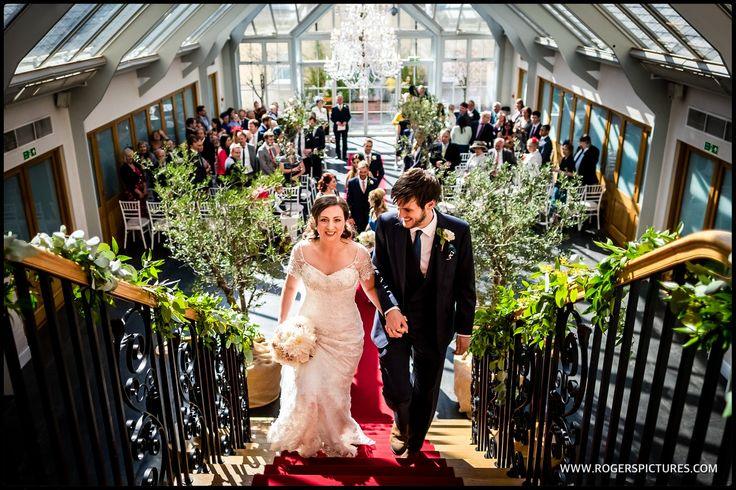 Leaving the ceremony as man and wife at Botleys Mansion -