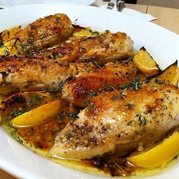 Pressure cooker lemon garlic chicken recipe.Whole lemony chicken with garlic and fresh herbs cooked in pressure cooker.