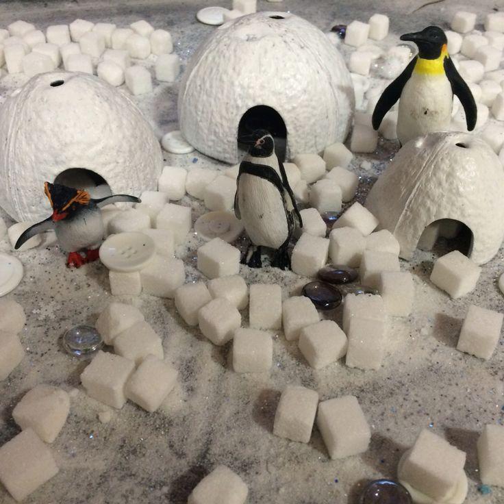 Antarctica polar small world. Sugar snow, sugar cubes, glass pebbles, white buttons penguins and sparkle.