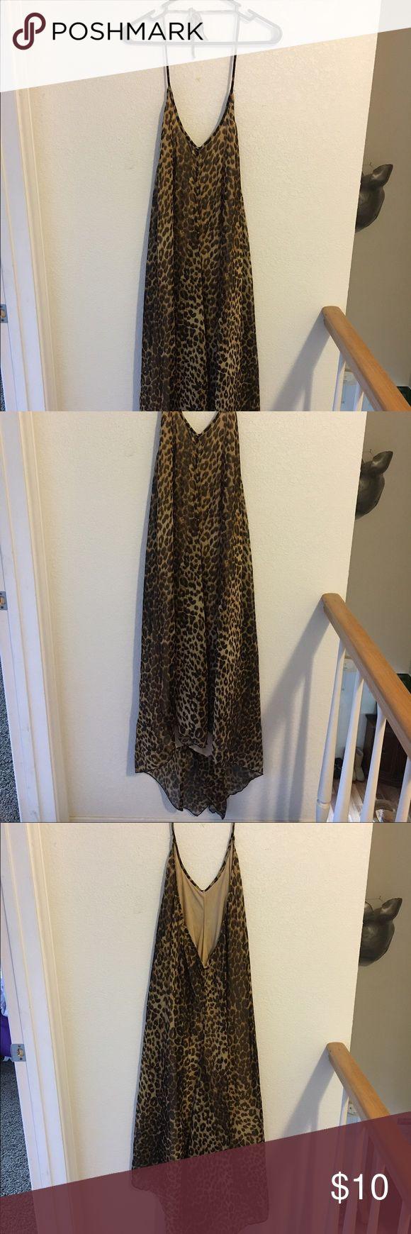 Leopard maxi dress Very flowy leopard maxi halter dress. Size L. Open back. Very comfortable resort wear. Dresses Maxi