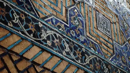 The Art of Timurid: A set of tiling (on Ali Mosque front wall) in cobalt blue dominated polychrome foliages and square kufic inscription which bears the name of God Almighty. Esfahan, April 2017