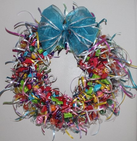 A Candy Wreath diy ... http://ediblecraftsonline.com/candy_bouquets/cb19/index.htm
