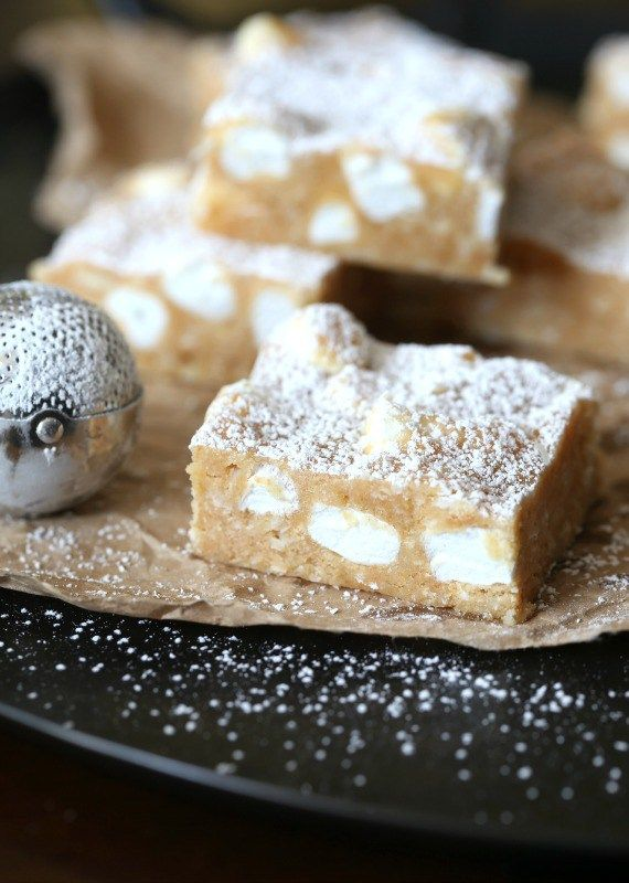 """These NO Bake """"Snow Drift Bars"""" are a delicious combination of a custard base mixed with crushed Nilla Wafers, coconut and marshmallows!"""