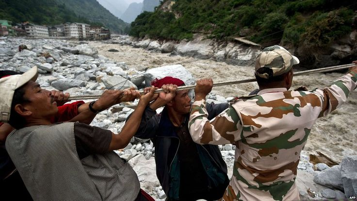 Indo-Tibetan Border Police (ITBP) personnel and local residents pull a rope to rescue stranded pilgrims on the other side of a river at Govind Ghat on 23 June 2013 Posted by floodlist.com #Uttarakhand #Floods