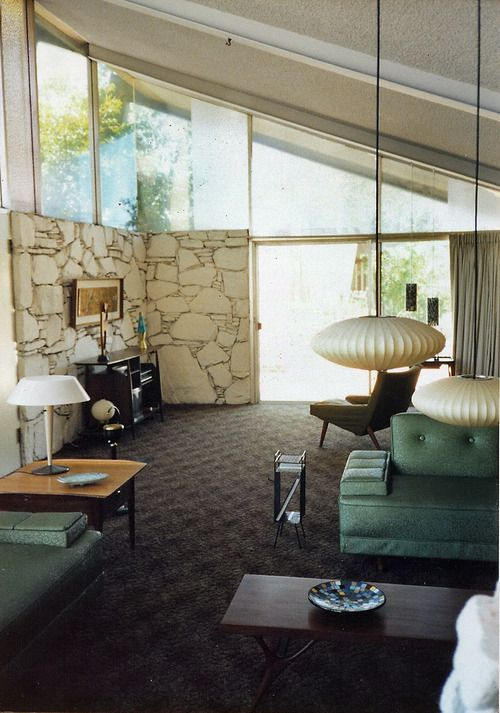 1950s home - There's just something about those slanted ceilings hung with George Nelson bubble lamps, those slanted clerestory windows... still looks modern & chic over half a century later.