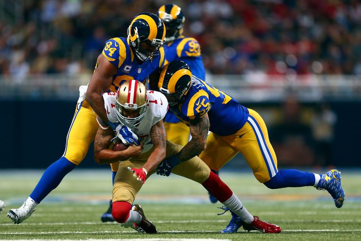 Colin Kaepernick #7 of the San Francisco 49ers is sacked by Robert Quinn #94 and James Laurinaitis #55 of the St. Louis Rams in the fourth quarter at the Edward Jones Dome on November 1, 2015 in St. Louis, Missouri. (Oct. 31, 2015 - Source: Dilip Vishwanat/Getty Images North America)