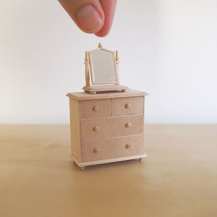 Make a tiny chest of drawers and dressing mirror in the English style for your dollhouse with this small tutorial.