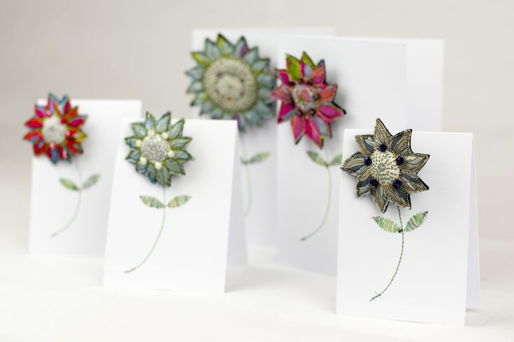 Handmade textile flower brooches in a variety of lovely colours and