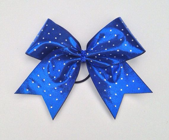Royal blue rhinestone cheer bow with a royal blue 3 base ribbon and a blue glitter center. This sparkly cheer bow is amazing. If you want a team order or more than 10 bows convo me for discounts and a custom listing. Add this Big cheer bow from Front n Center Cheerbow to