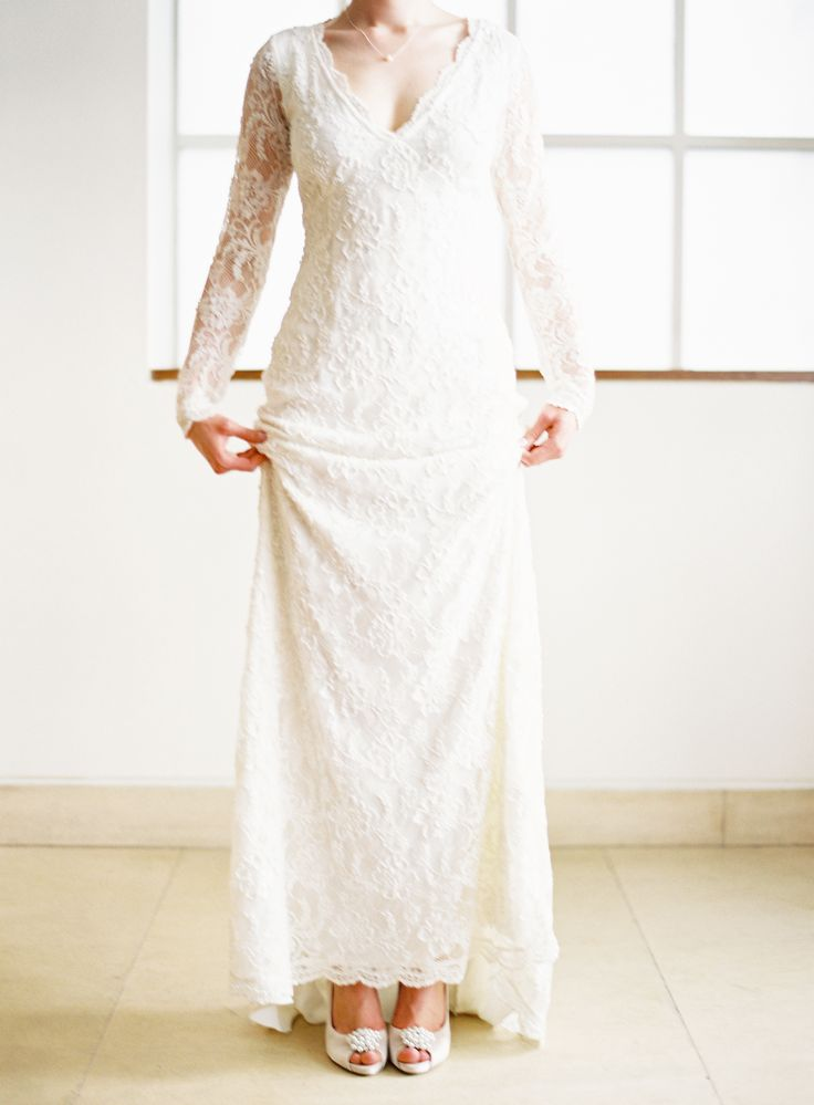 Bride wears the Evelyn Wedding Dress and Alice Slingback Shoes ...