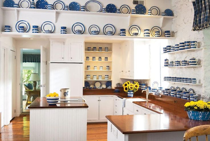 Cherry countertops in the kitchen were finished with ship's lacquer. Blue and white dinnerware serve as the perfect complementary backdrop.