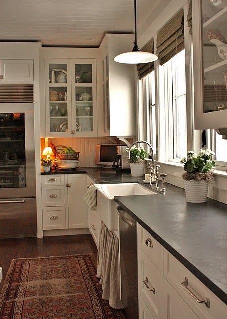 Soapstone counters, farm sink, white cabinets
